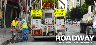 Roadway asphalt striping
